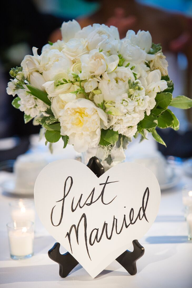 White flower arrangements with heart shaped sign izmirmasajfo