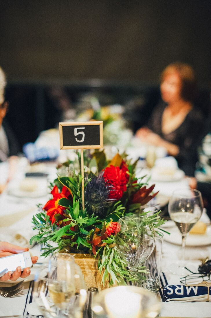Chalkboard table numbers with red dahlia centerpiece