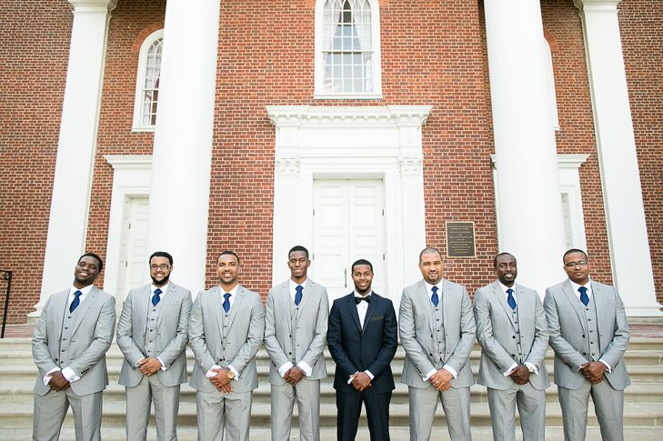 The groomsmen wore gray J.F. Ferrar suits with navy ties. Aaron wore a custom Indochino tuxedo.
