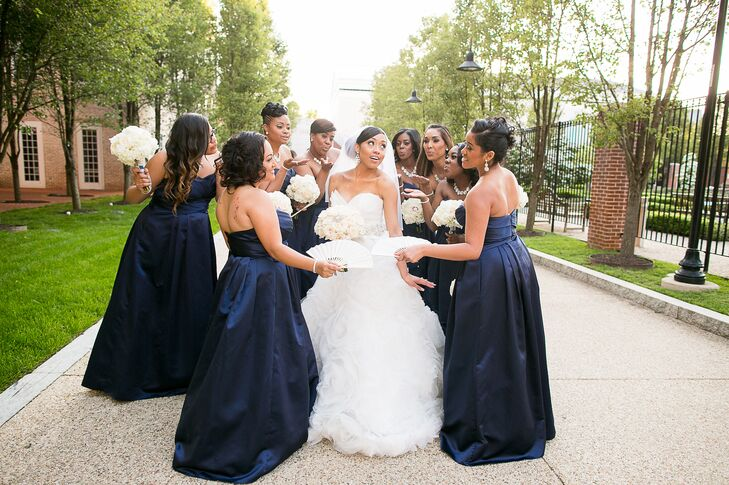The bridesmaids wore navy satin dresses with sweetheart necklines from David's Bridal.