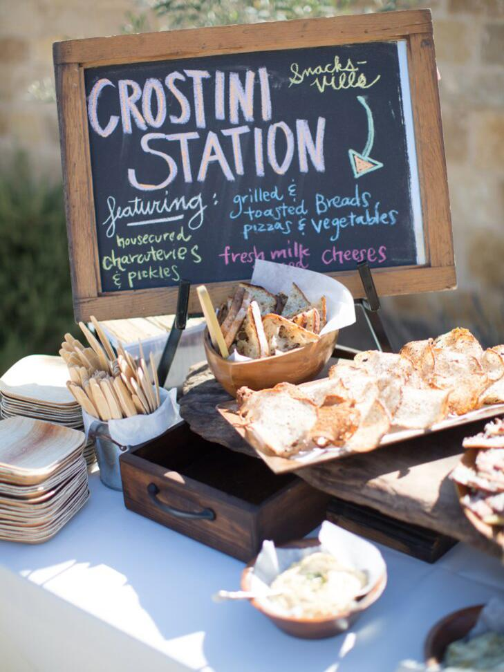 A crostini station at an outdoor wedding reception