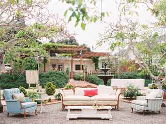 Outdoor wedding lounge with couches and side tables