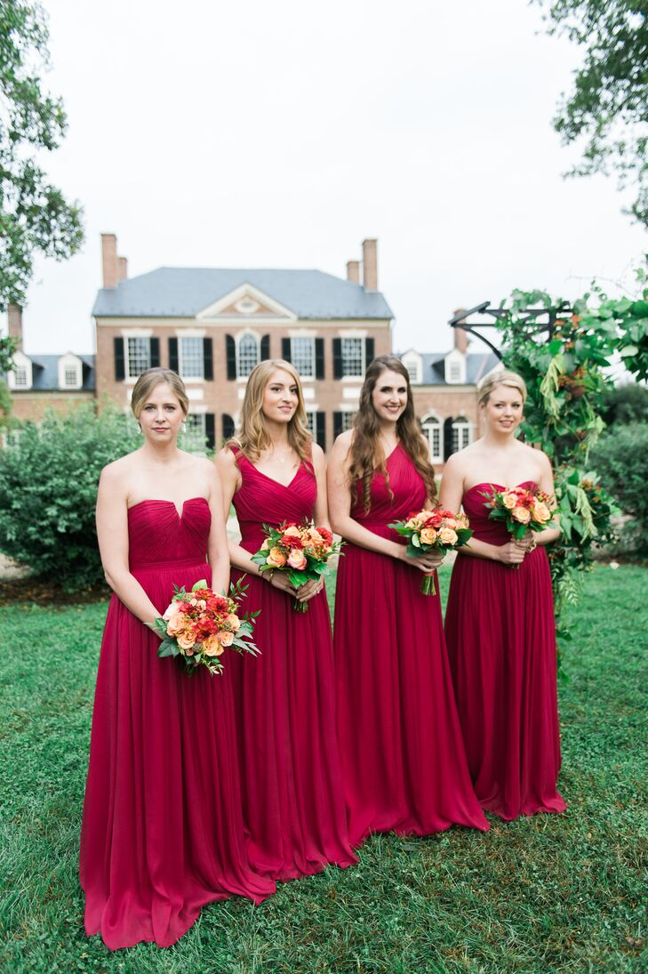 The bridesmaids wore floor-length burgundy J.Crew dresses in different styles, chosen by the ladies themselves. The peach roses incorporated into their bouquets popped against the color of their dresses.