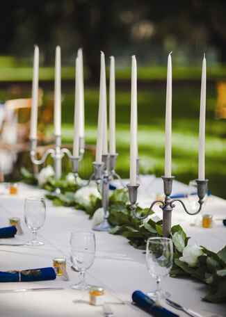 Candle and garland nonfloral wedding reception centerpiece