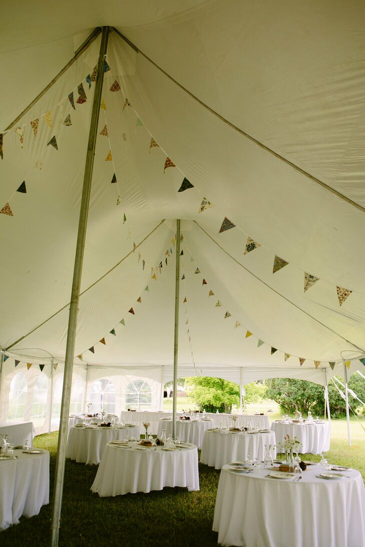 Inside, the pitched reception tent was lined with patterned pennant bunting.