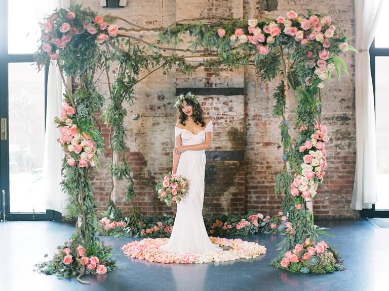 White birch wood Chuppah with roses and greenery