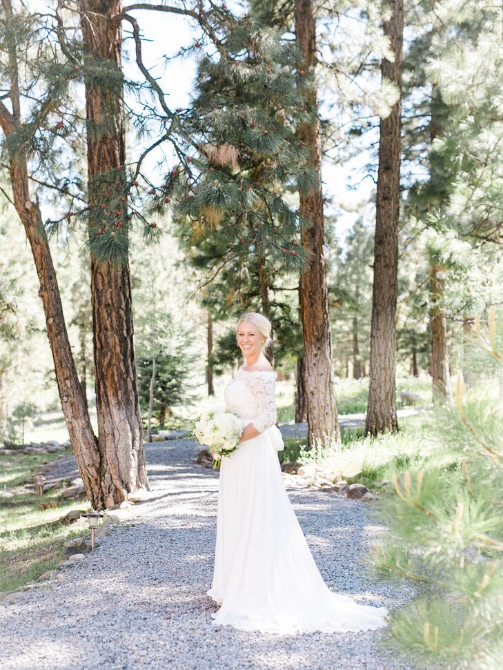"""Once again, I have always wanted a timeless look and feel for my wedding dress,"" says Kassi, who chose a long-sleeved gown by Amy Kuschel. ""The dress has a lace top with a silk and chiffon overlay for the bottom. It had an empire waistline and the option for a topper. I knew that for the ceremony I wanted a modest look, so the option for the lace topper was perfect."""