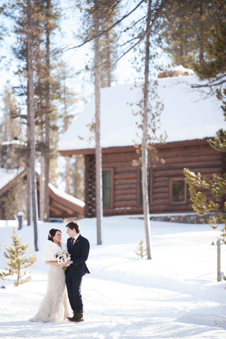 Couple Standing Outside In The Snow