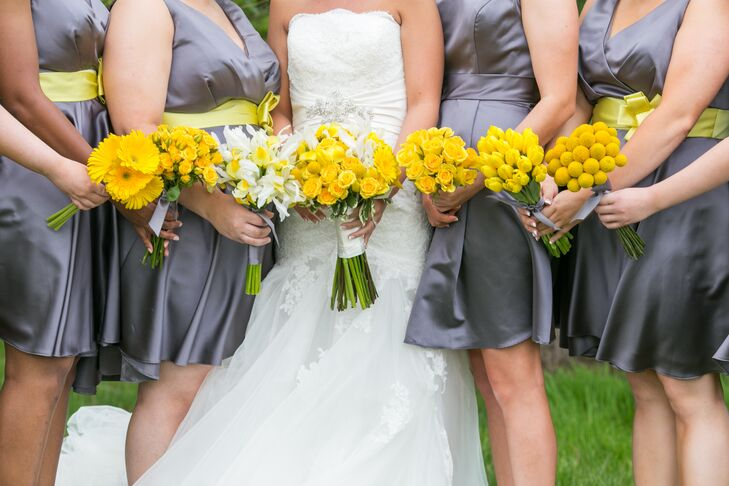 The bridesmaids wore knee-length gray satin dresses with yellow sashes. They each carried yellow bouquets of different flowers, including gerbera daisies, roses, craspedia, tulips and lilies. Tiffany's bouquet was a combination of these flowers.