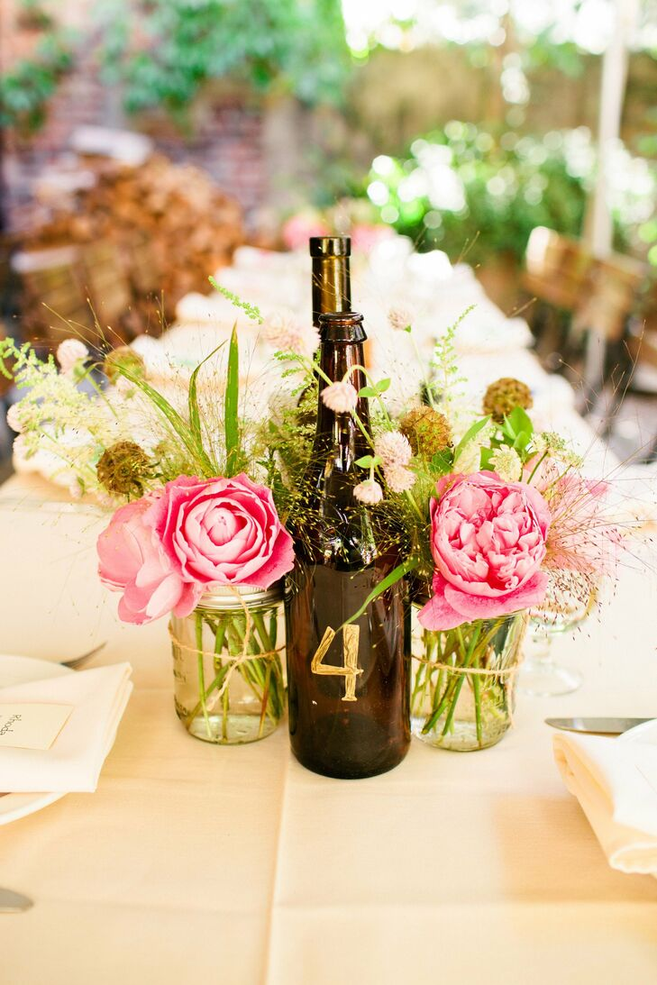 Wine bottle and mason jar centerpieces Wine bottle wedding centerpieces