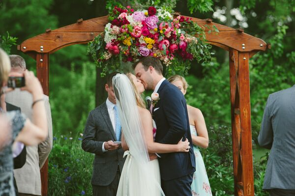 Wooden Wedding Arch With Flower Arrangement