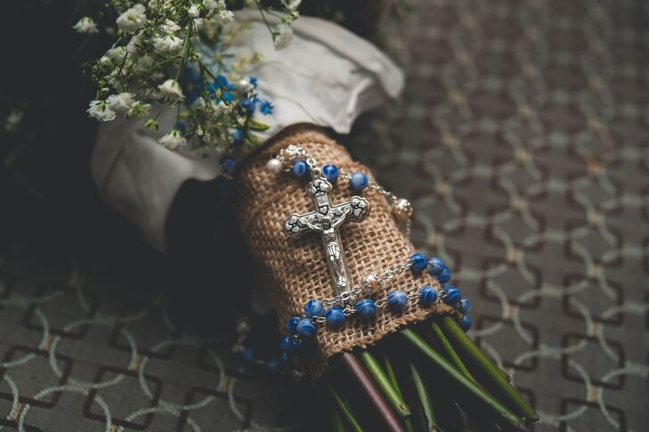 The bridal bouquet was wrapped with burlap and blue beaded rosary beads.