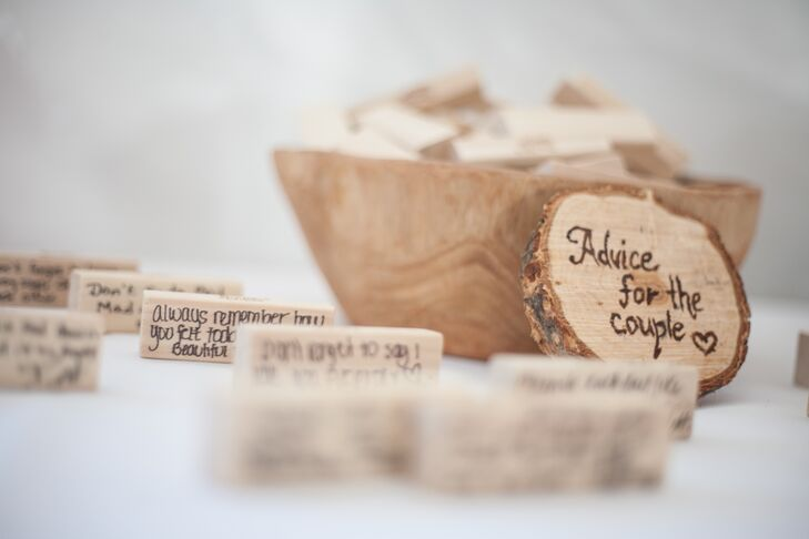 Instead of paper, Collin and Adrienne used wooden blocks for guests to write words of advice for them.