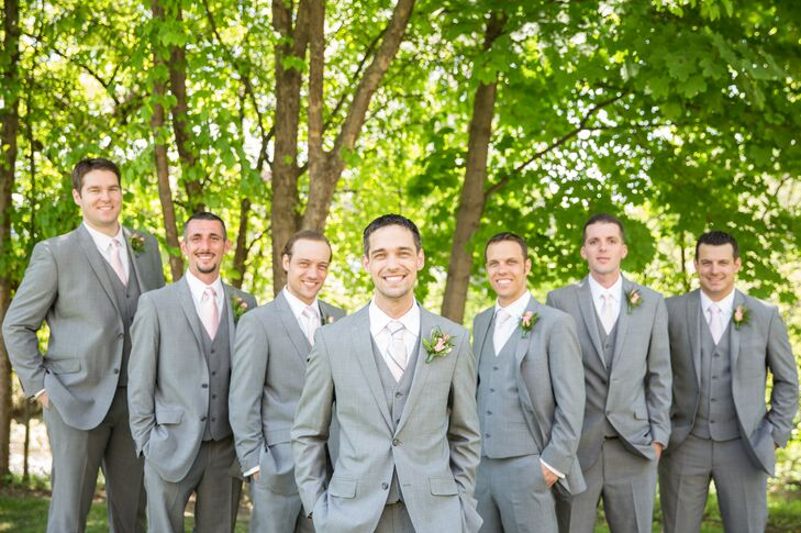 Groomsmen wore gray suits with blush colored ties and simple rose boutonnieres.