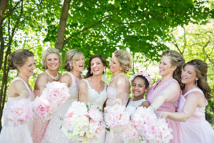 Bridesmaids wore mismatched blush dresses matching their bouquets of blush peonies.