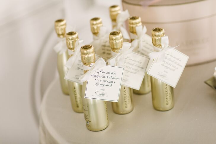 While Silje and her girls primped and pampered themselves before the day's festivities unfolded, they sipped on petite bottles of champagne. Silje customized the bottles with small ribbon-tied notes that thanked her crew for being by her side on her wedding day.
