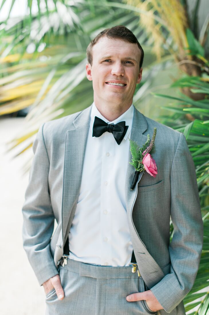 gray grooms suit with black bow tie