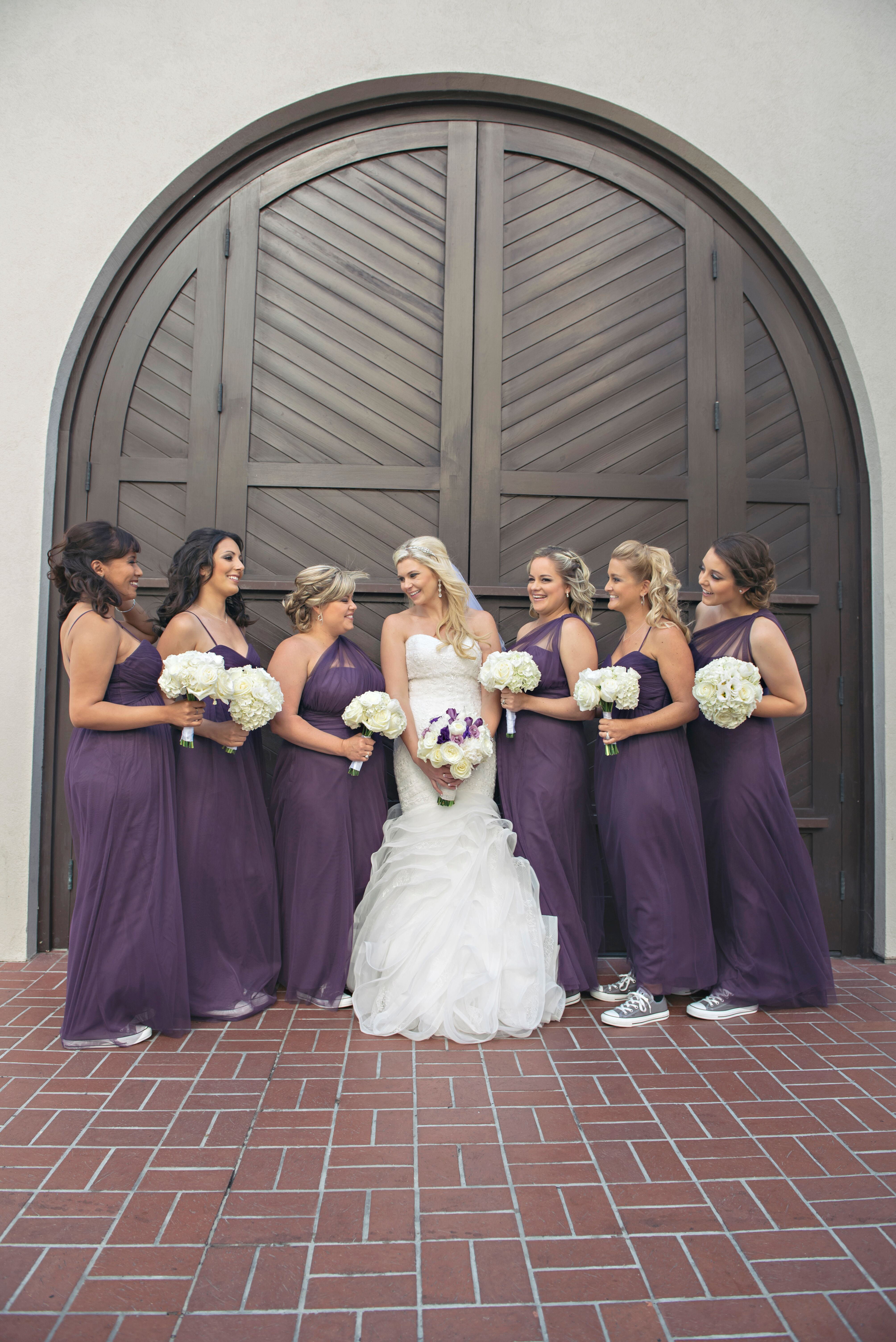 The Bridesmaids In Plum Bobbinet Dresses And Gray Converse