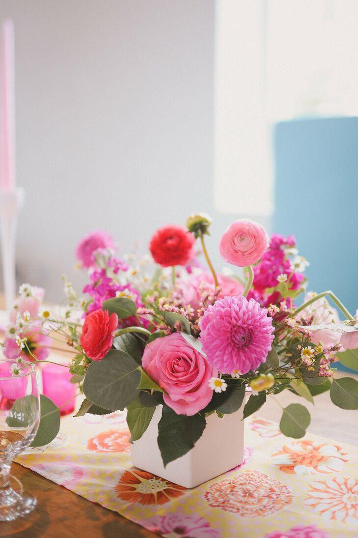 Pink rose and ranunculus centerpieces