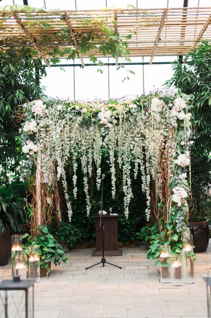 The couple wed in a traditional Jewish ceremony under a chuppah adorned with birch, willow branches and a lush floral garland.