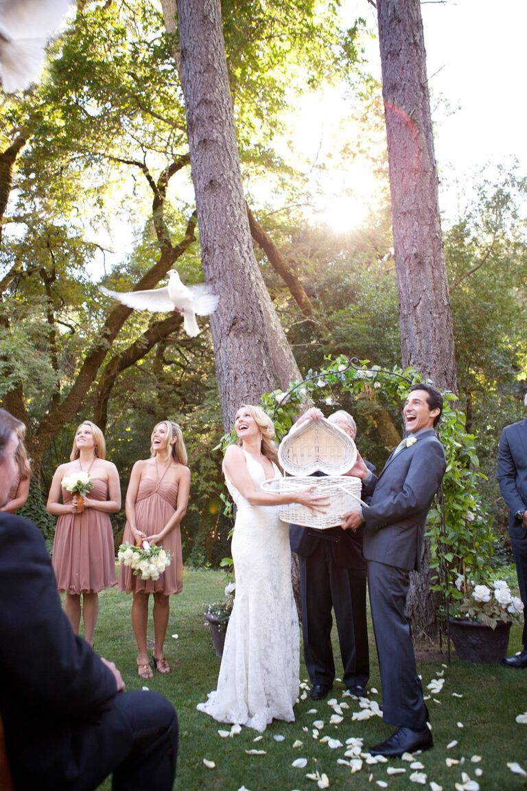 Bride and groom releasing doves