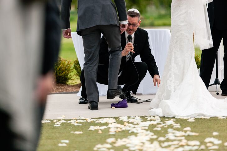 Following the Jewish breaking the glass tradition, Marc crushed a glass with his right foot at the end of the ceremony.