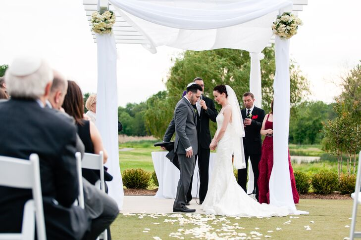 Marc and Yelena said their vows under an elegant white arch at the Galloping Hill Golf Course.