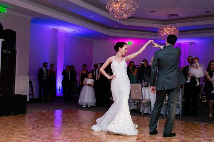Purple accent lighting created an intimate feel to the elegant reception.