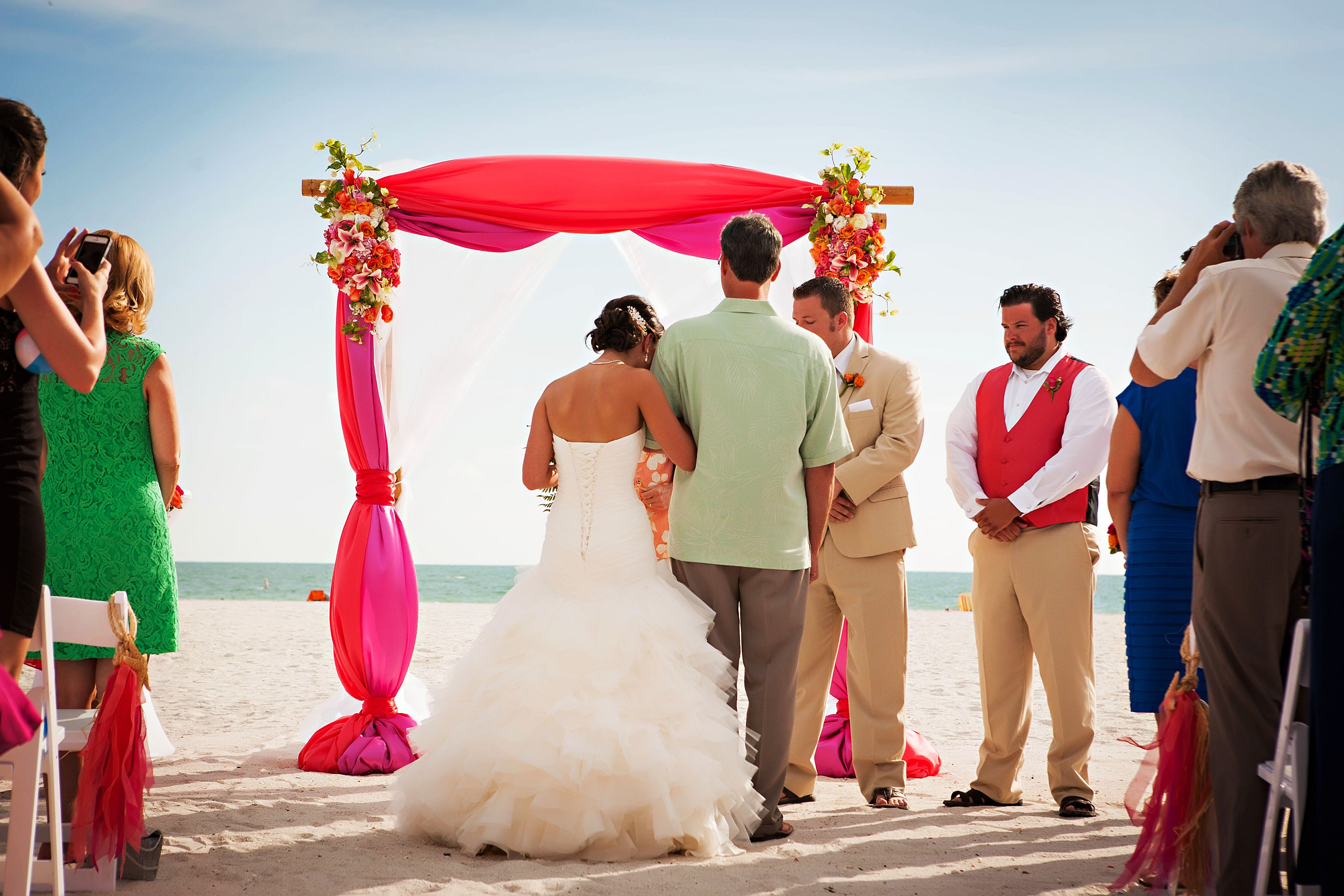 Vibrant guava and purple wedding arch ombrellifo Images