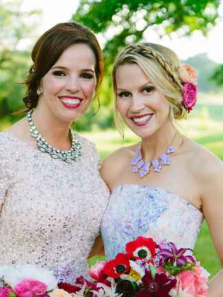 Boho bridesmaid updo hairstyle with fresh flowers and a braid
