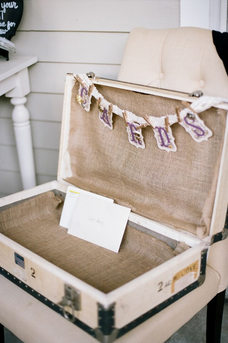 Antique touches exuding old world charm, like a vintage suitcase used as a card box, were a key element in bringing  Ashley and Sean's romantic vision to life.