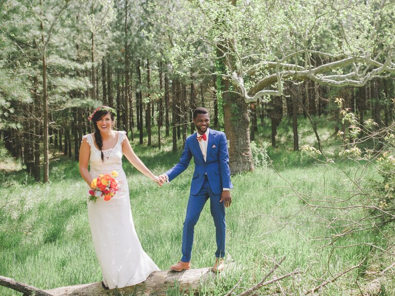 Bride with flower crown and groom in blue suit