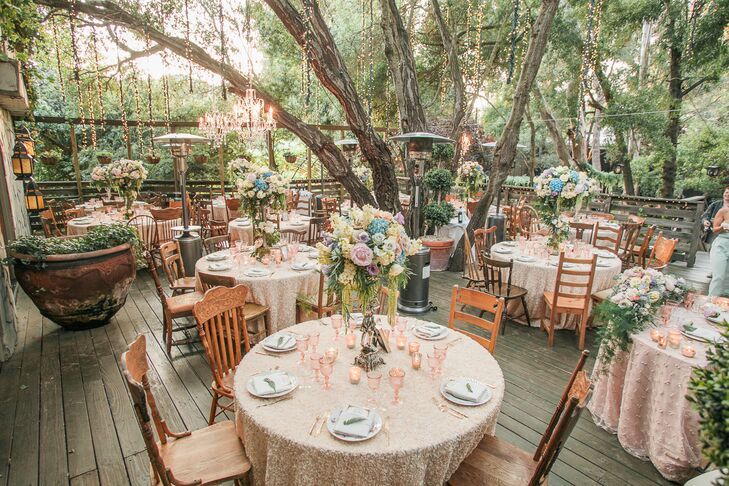 With the help of Bright Blue Events, Ashley and Johnathan transformed Calamigos Ranch's patio into a whimsical, garden-inspired scene with a palette of soft pastels, lush rose centerpieces, textured table linens and pink glassware. Gilded cutlery, mismatched floral dinnerware and elegant vintage accents were essential in instilling an element of old world charm.