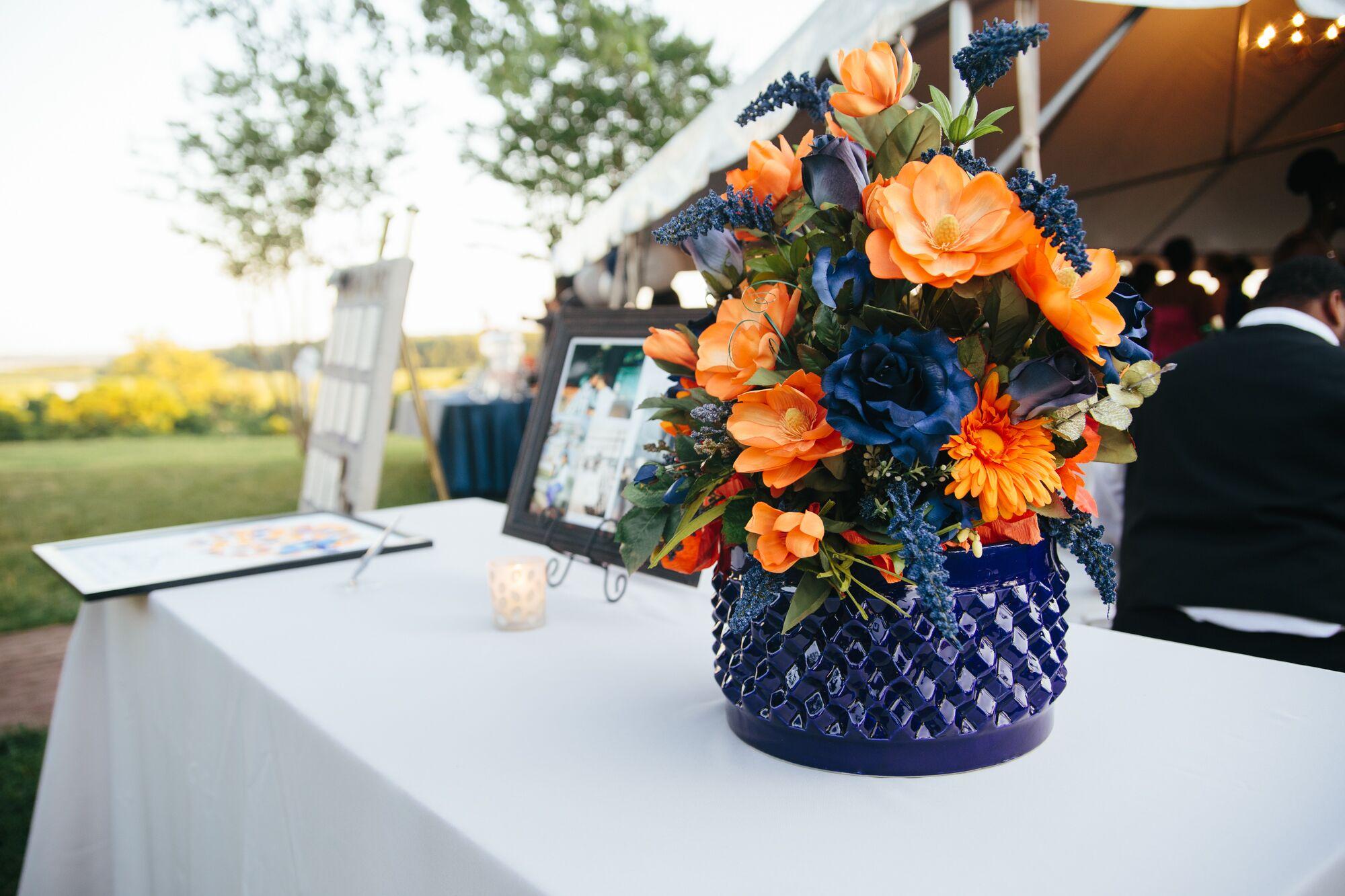 Orange And Navy Blue Reception Flower Arrangements