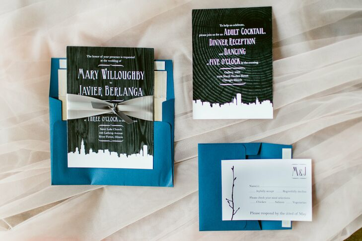 Mary and Jav worked with a graphic designer friend to create an invitation with the Chicago skyline silhouette and a black-and-white grain wood pattern, tied with a silver ribbon. The envelopes were bright navy blue with a silver lining. The couple printed the envelopes, invitations, programs, escort cards and menu poster board at home and assembled the invitation themselves.