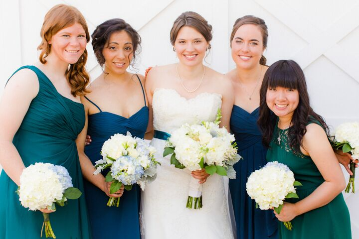 """I was determined not to be a high-maintenance, demanding bride, so I gave the girls a color palette and fabric material and allowed them to choose their own dresses from whatever source they wanted,"" Hannah says. ""I absolutely loved the way it looked, and everyone was happy with what they were wearing. One of the girls bought a dress she's already worn multiple times."""