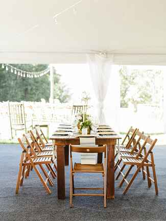 Opt for wood folding chairs instead of plastic for a more formal vibe