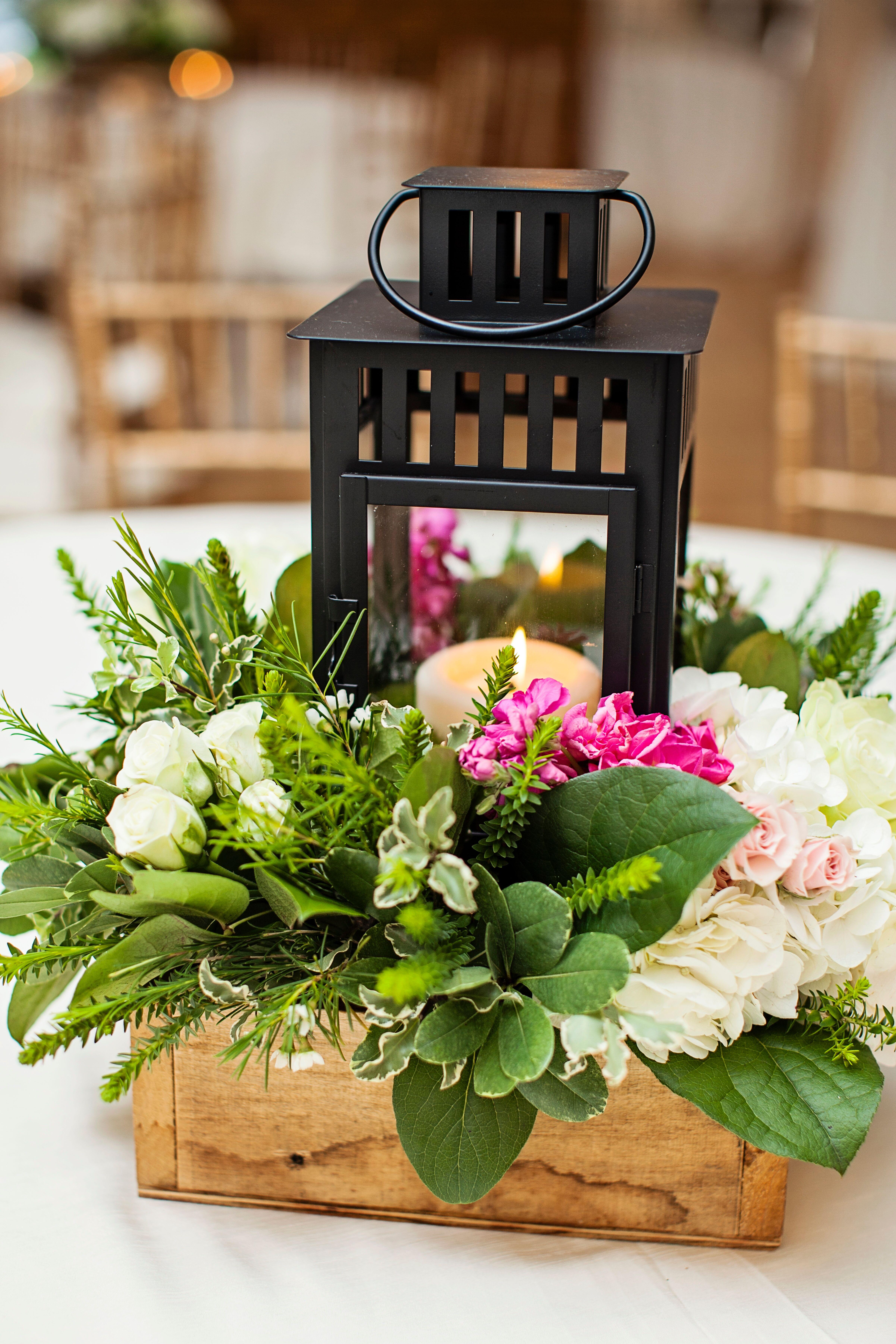 Black lantern centerpiece with fresh greenery