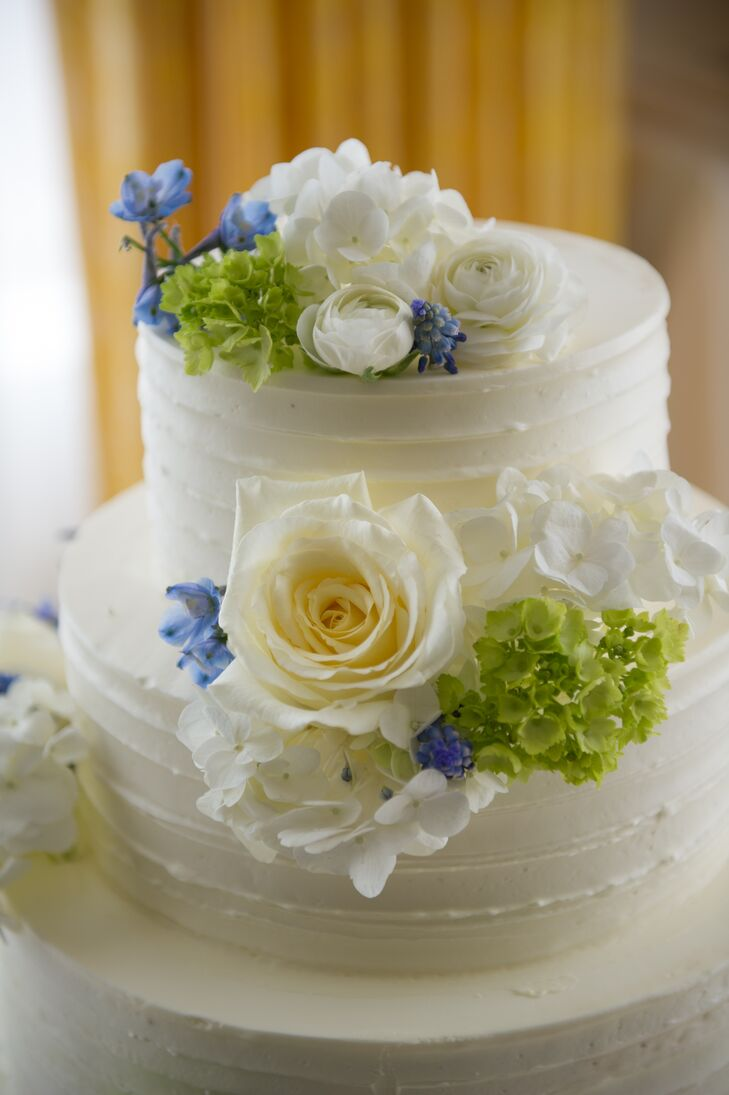 Three Tier Buttercream Wedding Cake With White, Blue and Green Flowers