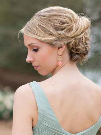 Messy low bun wedding hairstyle for brides or bridesmaids