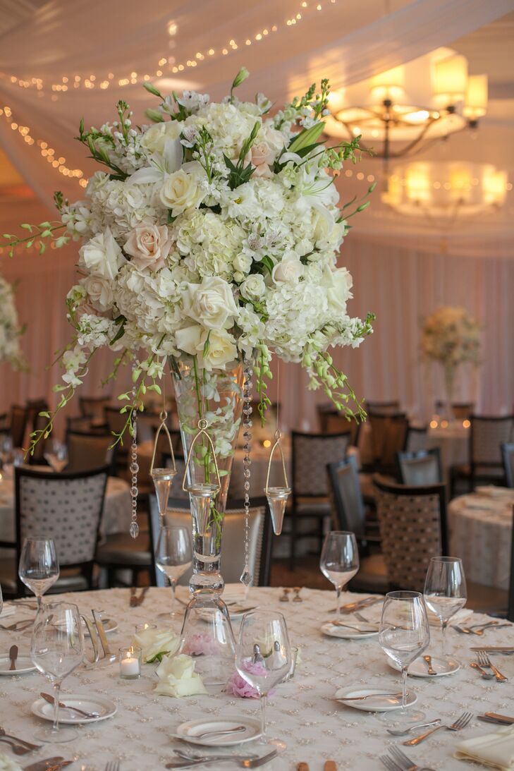 Tall white hydrangea and rose trumpet centerpieces