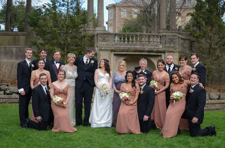 Wedding Party Dressed in Rose Gold and Classic Black and Ivory Tuxedos