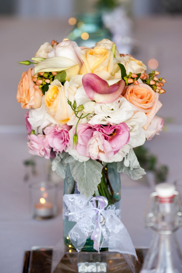 Mason Jar Centerpieces With Peach Pink And White Flowers