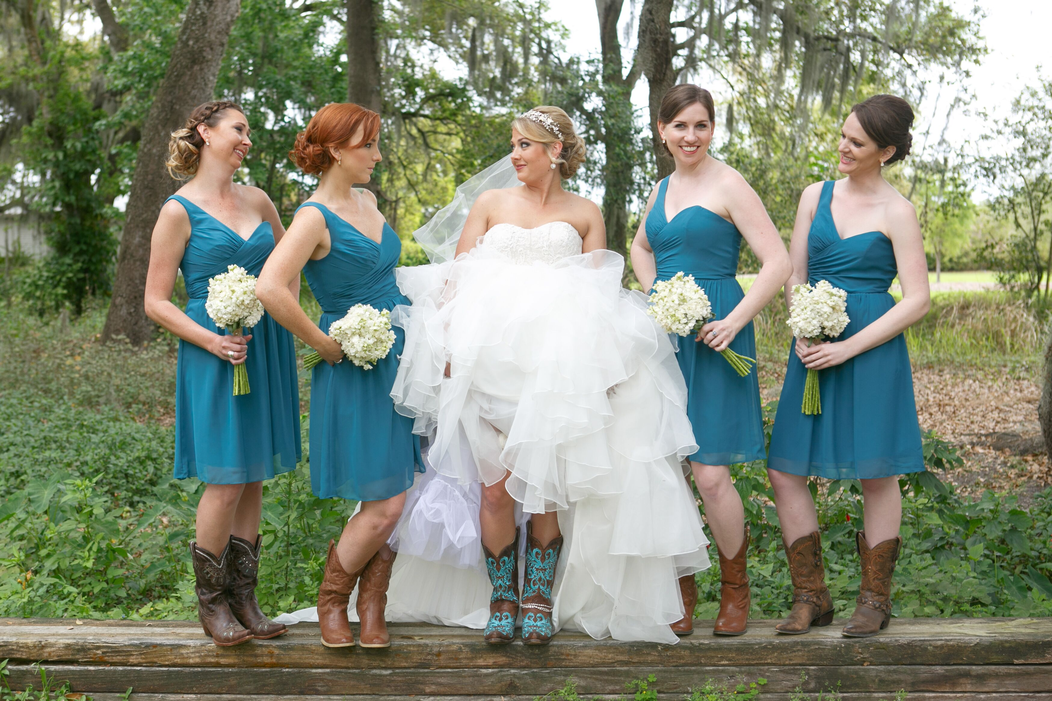 Rustic wedding arch with draped burlap short teal one shoulder bridesmaid dresses ombrellifo Images