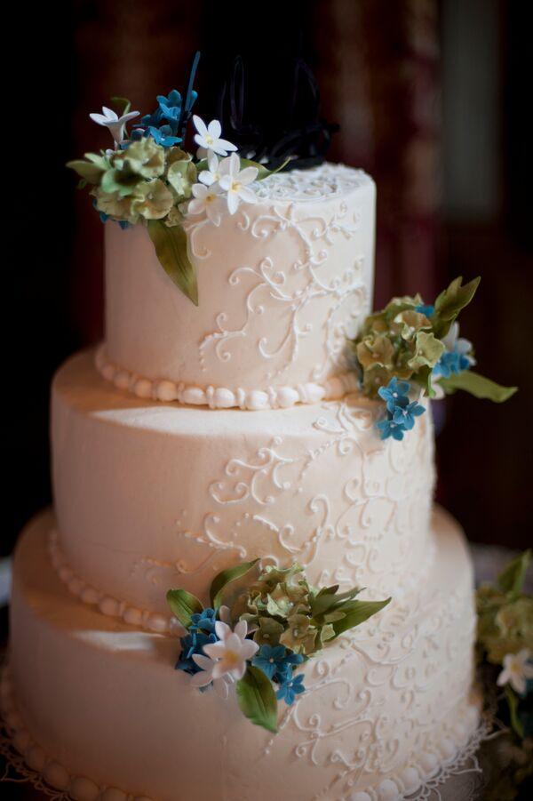 Ivory Wedding Cake With Green, Blue and White Flowers