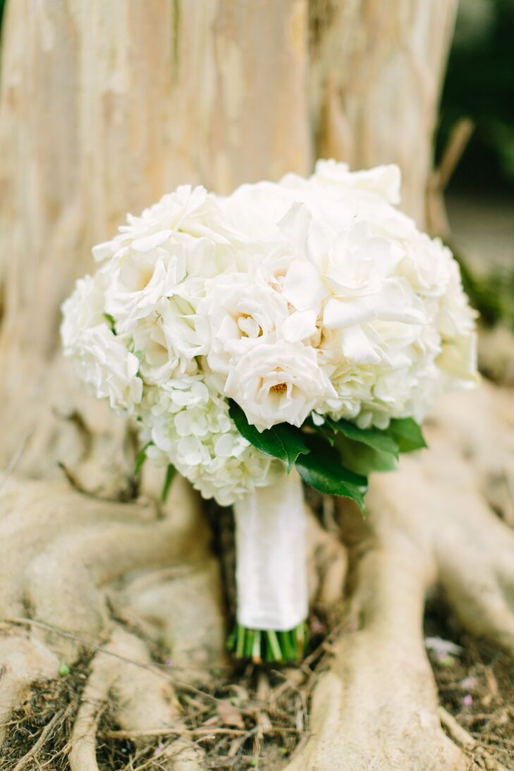 "Chelsea and Aaron knew they wanted to keep their palette mostly neutral. With that in mind, Events In Bloom created a stunning bouquet of roses, gardenia and hydrangeas. ""The gardenias also added a beautiful aroma to the bouquet that I can still remember,"" Chelsea says."