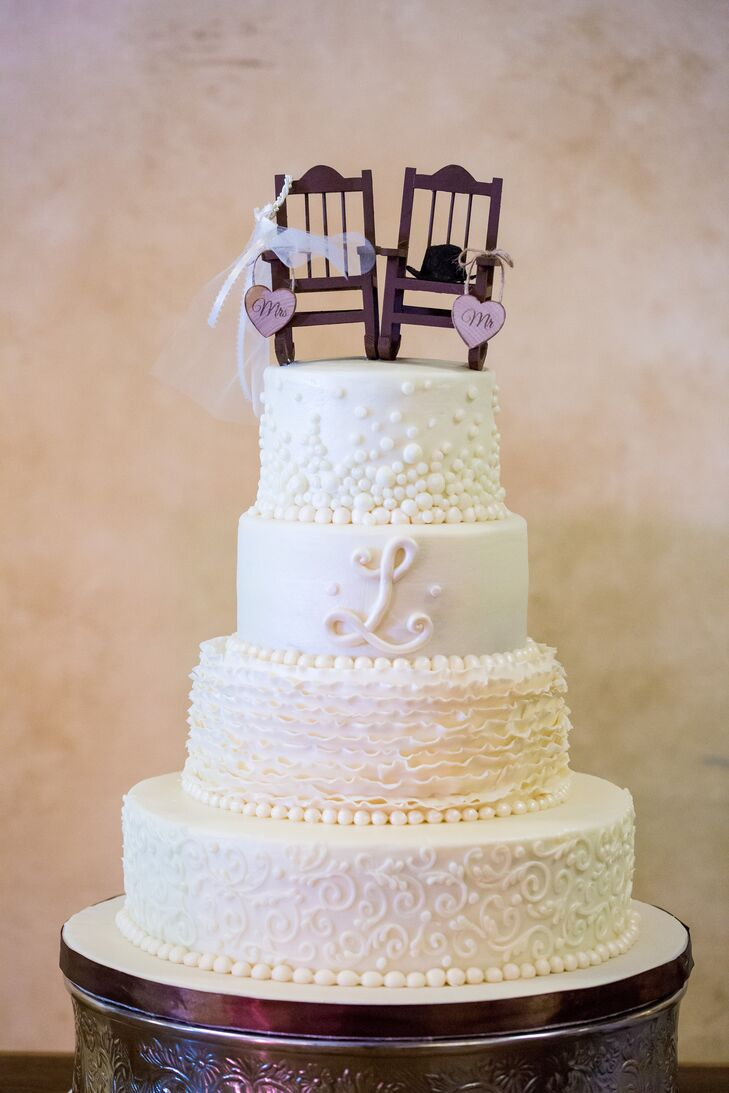 White Detailed Wedding Cake with Rocking Chair Topper