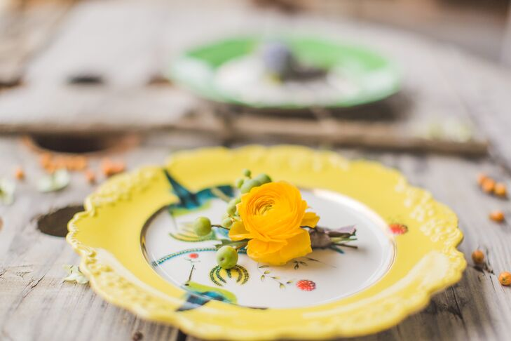 Yellow Ranunculus Flower on Yellow Plate