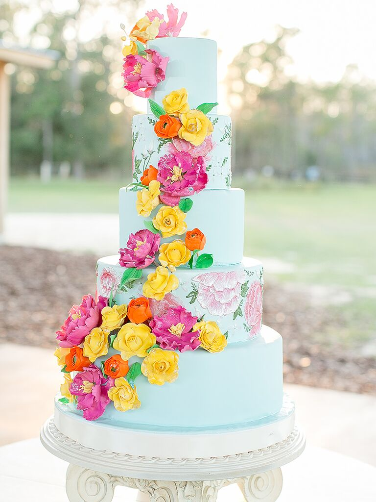 Bright Blue Wedding Cake With Sugar Flowers And Handpainted Designs