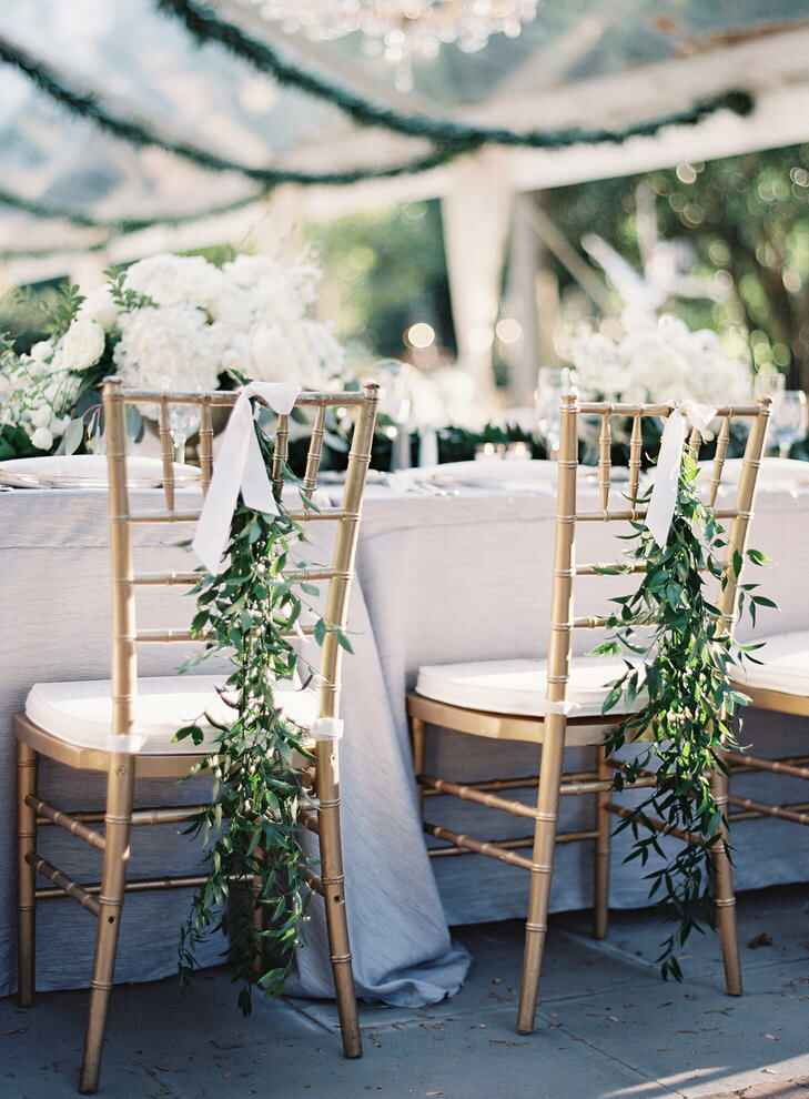 Garlands accenting the newlywed chairs